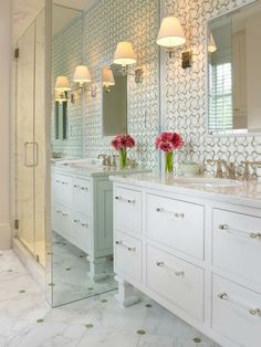 Interior Design Ideas - White bathroom, green and white tile and floor to ceiling mirror on the shower wall. Pink flower accent.