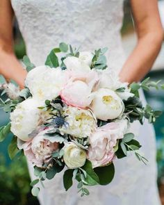 A Tennessee Wedding at the Couple's Log Cabin Home | Martha Stewart Weddings - Memree carried a hand-tied bouquet by Enchanted Florist made up of white peonies, blush peonies, a touch of thistle, dusty miller, and a few small gray feathers.