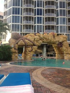 Best Resort Pool on Fort Myers Beach.  Zero-Entry design with coral arch and waterfall.  Pool deck offers lounge chairs, plush pool towels, and cocktail servers to bring you a drink while you unwind.