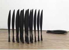 Lucy Skaer: Black Alphabet (After Brancusi), 2008, 26 dust coal sculptures