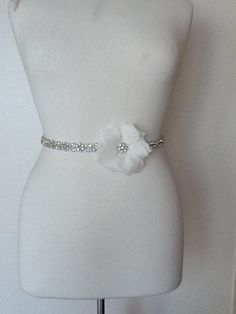 Crystal rhinestone and tulle flower wedding dress belt. $99.00, via Etsy.