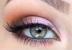 A pretty light purple eye shadow with golden orange accent along the brow bone