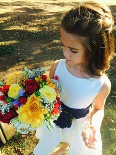 Flower girl with bridal bouquet.