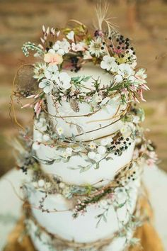 Wedding cake. Floral, feather, vine, berry, greenery. Simple & earthy.