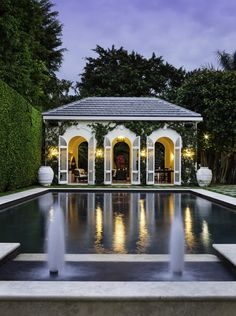 A classic French inspired pool house is ready for entertaining. Modern Exterior, Exterior Design, French Pool, Country Pool, Pool House Designs, Best Modern House Design, Custom Pools, Pool Houses, Outdoor Pool