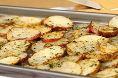 baked herb and parmesan potato slices 2 whole russet potatoes (medium size) 2 whole large red potatoes ¼ teaspoon onion powder ¼ teaspoon salt ¼ teaspoon garlic powder ¼ teaspoon dried oregano ¼ teaspoon dried thyme ¼ teaspoon pepper ¼ teaspoon dried parsley ¼ teaspoon dried rosemary 2 tablespoons olive oil 1 tablespoon grated parmesan cheese  DIRECTIONS:  Preheat oven to 375 degrees F. Bake for 20 min