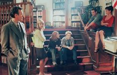 The whole cast in the school library.