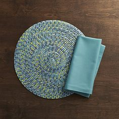 A kaleidoscope of oceanic shades spiral in this textural round placemat made of dyed, braided and woven paper. Lightweight and flexible, the casual, colorful placemat is ideal for everyday use.