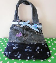 facebook.com/happy.hayes.bespokebagsandaccessories    Floral denim vintage bag     £15.00