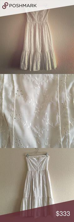 Vintage 1970s Eyelet Strapless Midi Dress Vintage 1970s white cotton eyelet strapless midi dress. Zipper at center back. Handmade. Some slight discoloration from age. Dresses Midi