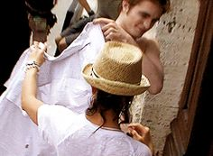 {gif} I want to be her and pretent Rob can't put on his own shirt LOL!