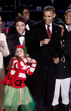 President Barack Obama danced with a young performer as he attended the National Christmas Tree Lighting ceremony near the White House in Washington on Dec.6,2013
