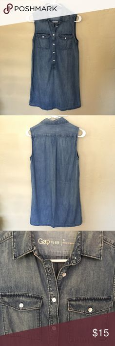 Gap Denim Dress Size S Sleeveless popover denim dress by Gap. White buttons for a nice contrast. Hits above the knee. Straight fit, fun with a belt. Can be layered over a t-shirt or long sleeve. Great condition.   Styled with Anthropologie top listed in my closet.   Bundles and offers welcome. GAP Dresses Strapless