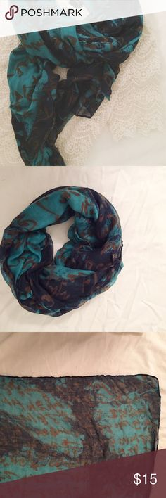 Navy printed scarf Worn once. One of a kind scarf that can be worn wrapped around the arms or twisted around the neck! Good condition Accessories Scarves & Wraps