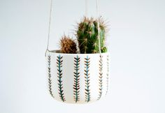 Small ceramic hanging planter for succulent or cacti plants. This planter is ready to hang it in a roof, shelf or nook of your house creating an confortable ambient. The planter has been handmade in my little studio. In each little planter there are a short personal story wich talk about to a moment or feel in my life. I hope you can feel all the dedication and affection that I have used doing this item. The planters touch is really soft and their colors are brilliant. Has been made to…
