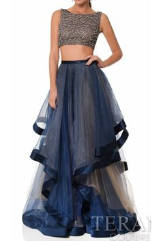 Terani Couture 2 Piece Long Tulle A Line Steel Gown Prom Dress | Poshare Make a statement in a flirty tulle two piece gown from Terani Couture 1611P1369. Featuring an ornately beaded high neck bodice and unique layered skirt. Rent this dress for your next event.