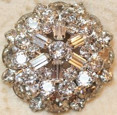 Weiss Silver Tone Domed Rhinestone Rodium Plated Wedding Brooch Pin is a layered and domed stack that is stunning The outer circle of stones appear to be a smoky color