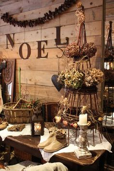 NOEL - rustic Christmas decor- could use Tomato cage tree by louisa Primitive Christmas, Noel Christmas, Country Christmas, Winter Christmas, All Things Christmas, Vintage Christmas, Christmas Crafts, Cabin Christmas, Grapevine Christmas