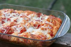 Bubble Up Pizza - Toss biscuits in pizza sauce and cheese, top with your favorite toppings, and bake! It's the fastest, cheapest, and easiest way to make a pizza ever!