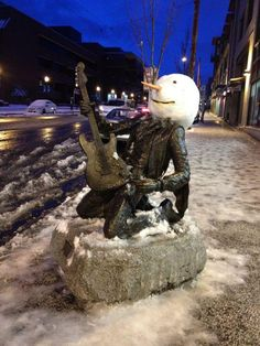 when it snows in seattle-Haha. I remember seeing that statute in person...it's Jimmy Hendrix.
