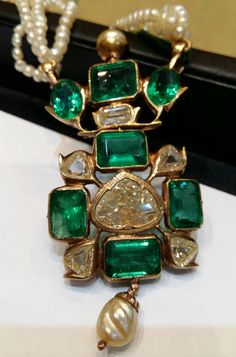 COLOMBIAN EMERALD AND DIAMOND ANTIQUE INDIAN PENDANT.  Rose cut central diamond: 2.70cts Old diamonds: 3.70cts Old colombian emeralds: 18 cts. 2 Natural pearls. www.gutgalgems.com