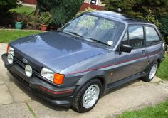 Fiesta XR2 mk2 mercury grey. Had a couple of these in the 90's...best cars I ever bought. Exhausts kept dropping off though..or maybe that was my driving.