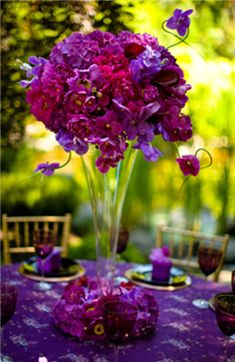 Lovely tall and purple orchid centerpiece. #purplecenterpiece #purplewedding #flowers
