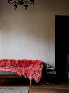 this pink fluffy throw is everything