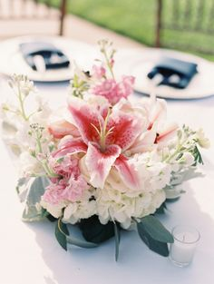 Amaryllis and white hydrangea wedding flowers: http://www.stylemepretty.com/oklahoma-weddings/oklahoma-city/2016/09/30/pink-navy-garden-wedding/ Photography: Sheradee Hurst - http://sheradeehurstphotography.com/