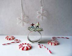 "Adjustable Silvertone Miniature Diorama Ring ""Snow Day Ice Skating"". $23.00, via Etsy."