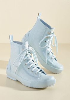 You're all about being open-minded, which is why you add these pale blue rain boots to your drizzly day ensemble! With a pebbly, textured finish and sneaker-like sensibilities, these fun Rocket Dog hi-tops are sure to broaden your fashion horizons.