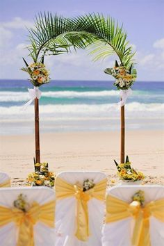 yellow and green beach wedding arch