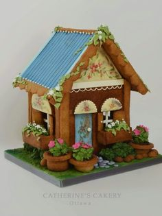 Catherine's Cakery | cute gingerbread cottage with spring or summer flowers