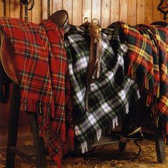 Tartan Throws. If you go to this website and click on Tartans at the top of the page, all of the Scottish clan names will be listed along with photos of their tartan.