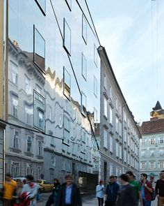 Presence and dematerialization  The residential building 'Stadthaus Ballhausgasse' fills a long-time void in the historic city centre of Graz, Austria. The d...