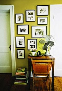 chartreuse walls with white trim and black frames... so clean and perky