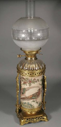 Zsolnay Pecs aesthetic movement oil lamp column base decorated with birds and flowers and with a Japanese style open fret gilt metal base and supports, having fluted cut crystal font and etched glass shade, 28''.12/ L500U