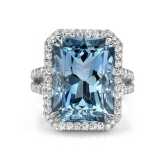 Omi Privé Aquamarine and Diamond Ring..  18k white gold cocktail ring is handcrafted with an 11.0 ct. radiant-cut aquamarine center accented with a frame of 1.60 cts. t.w. diamonds that run down the split-shank.      SKU RC1210-AQRA     Brand Omi Privé     MSRP $27,500.00