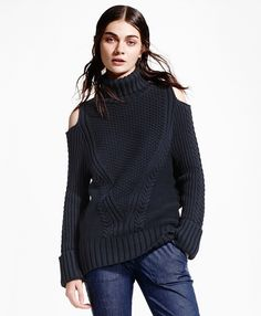 The chic turtleneck sweater made from comfy Italian cotton-blend yarns features an allover novelty cable knit, cutout shoulders and a semi-slouchy fit. <br/><br/> 26''; dry-clean; imported.