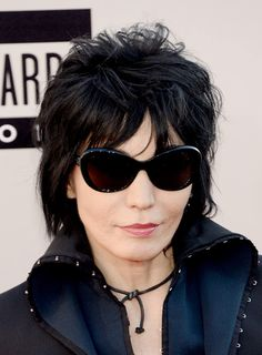 Joan Jett Layered Razor Cut - Joan Jett stuck to her usual edgy layered razor cut when she attended the American Music Awards.