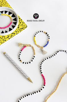 Take some colorful beads, add a tassel, and soon you'll have some fun bracelets that are perfect for stacking.