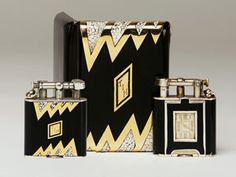 black and eggshell enamel, gold and silver Dunhill lighter, 1920s.