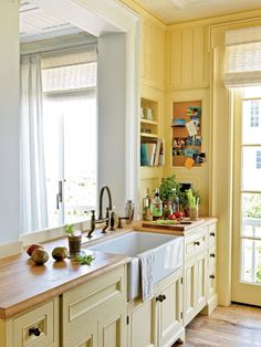 Sunny yellow, cream and butcher block ~ love the built-in in the corner.