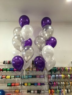 Mix of purple, silver and white latex balloons on a floor arrangement of 9 balloons