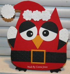 I've been wanting to get this Sizzix Owl Die so I finally did. My vision was to make a Santa. I freehand the hat then added small scallop circle punches.
