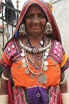 Banjara women are known for the elaborate mirror work and silver jewelry as well as very brightly colored costumes. | Banjara are nomadic people from the Indian state of Rajasthan, North-West Gujarat, and Western Madhya Pradesh and Eastern Sindh province of pre-independence Pakistan. | © Rachel ~ Lackawar on Flickr