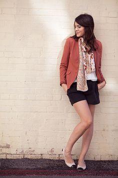 white shoes + black shorts + terra cotta blazer + white tee + floral scarf