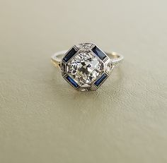 Antique 2ct European Cut Diamond Ring  I'd like the center stone to be a blue sapphire with diamonds on the sides!