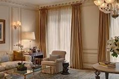 Double curtains to conceal excess light.