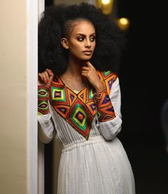 Image may contain: 1 person, standing Ethiopian Wedding Dress, Ethiopian Dress, Ethiopian Traditional Dress, Traditional Dresses, Ethiopian Beauty, Habesha Kemis, African Royalty, Embroidery Fashion, Dark Beauty